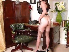 Busty brunette masturbates in vintage black seamed nylons