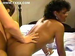 Hot interracial threesome in bedroom