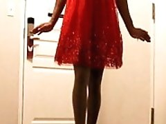 A 1950's SISSY DANCE FOR HER HUSBAND WEARING A PARTY DRESS