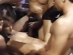 Blonde in Leather Chaps takes on 5 cocks